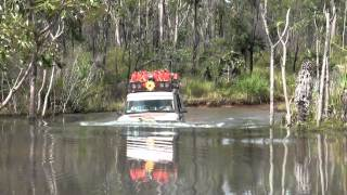 Crossing very deep creek. Australia Cape York Old Telegraph Track off road 4WD