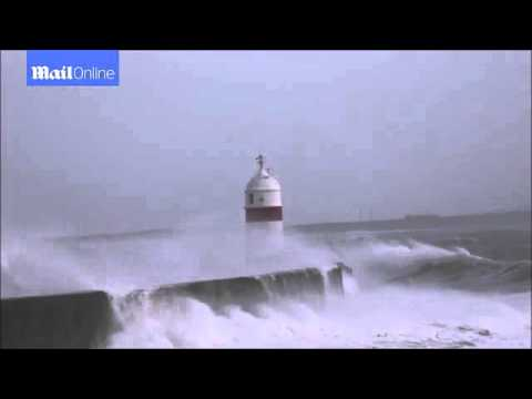 Storm Frank waves smash Castletown's lighthouse on Isle of Man