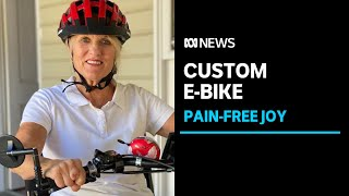 Tears of pain-free joy for double amputee riding an e-bike made just for her| ABC News