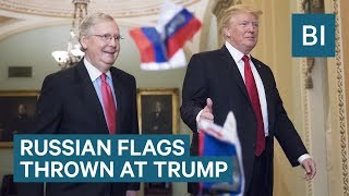Russian flags thrown at Trump as he arrives at U.S. Capitol
