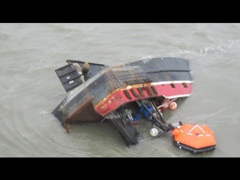 Six rescued from capsized barge in Singapore, five still mis