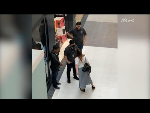 Woman caught on camera abusing Sydney retail worker in 'racially-motivated attack'