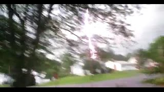 Lightning Strikes Telephone Pole - would have been dead if not on my porch