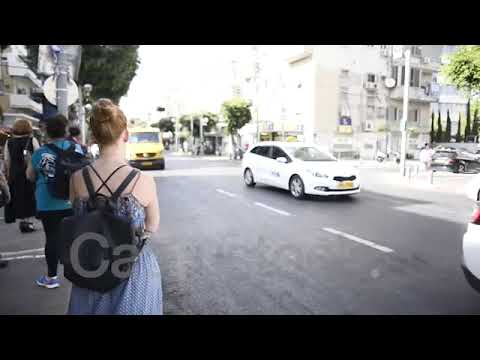 red-haired woman waits for Five bus line in tel aviv