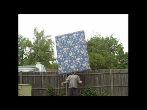 World Record: Longest Time To Balance A Queen Size Box Spring Mattress On Chin