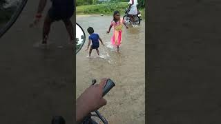 Little girls playing water