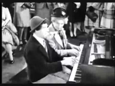 Chico and Harpo Marx in a piano duet