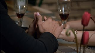 Closeup shot of a loving couple holding hands on a romantic dinner date at a restaurant - Valentine's Day