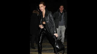 Hailey Baldwin flashes flesh in leather pants and snakeskin jacket