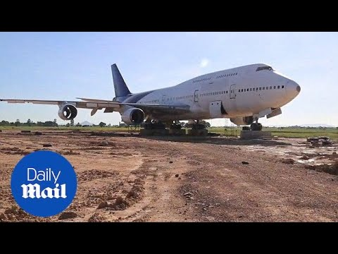 Thai villagers amazed to wake up to Boeing 747 in nearby field - Daily Mail