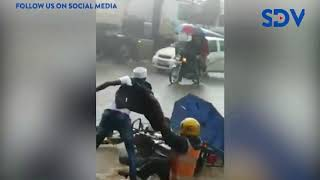 Dwellers treated to a comic skit at Eldoret town as passenger plunge into flooded highway