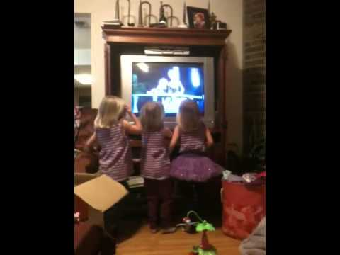 Triplet girls watching Barbie and the Popstar