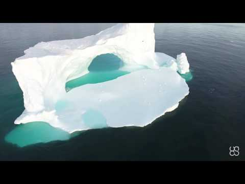 DJI PHANTOM 4 FLYING OVER ICEBERG NEAR GREENLAND