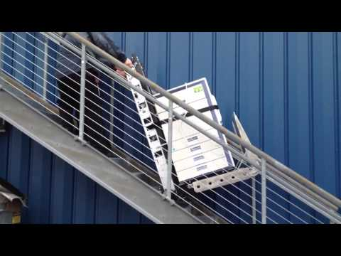 Moving 500# copier up the stairs - YouTube