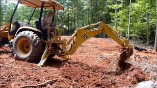 Deere 110 backhoe Working