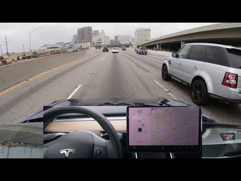 Tesla Autopilot on Narrow Highway with Traffic into Downtown