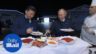 Chinese and Russian leaders enjoy pancakes with caviar and vodka