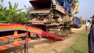 Trasporting Rice Combine Harvester