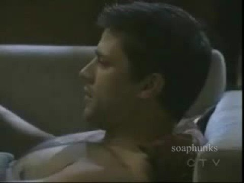 Greg Vaughan  shirtless on the sofa 3