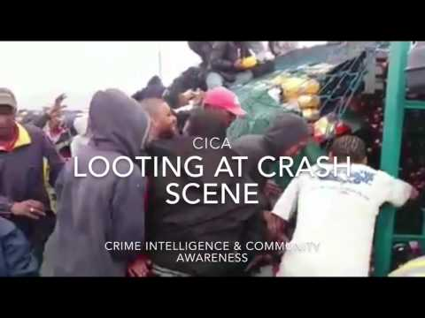 Looting of goods at accident scene. Truck crash-Cape Town South Africa attracts pillaging & looting