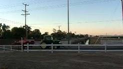 Farm tractor driving through El Centro, CA.