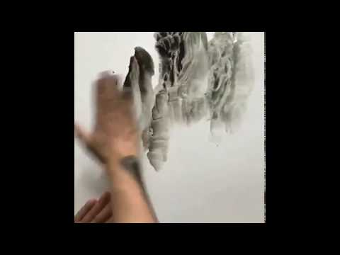 Watch and learn from this Chinese artist who can create an ink painting with his bare hand