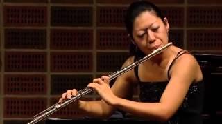 Butterfly on Japanese flutist Yukie Ota