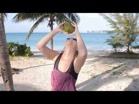 Easy Way to Open a Coconut. Junkanoo Beach, Nassau, Bahamas.