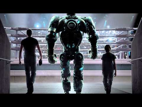 REAL STEEL MOVIE REVIEW, starring Hugh Jackman and Evangeline Lilly.