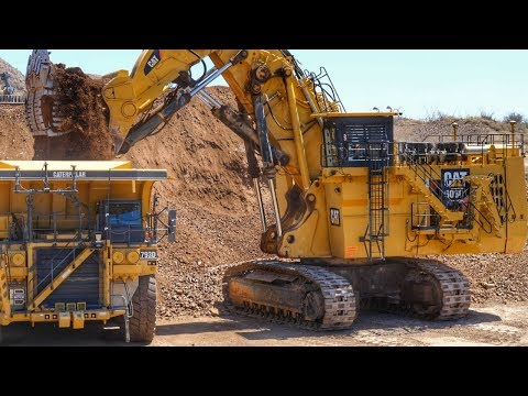 Caterpillar 6060 Face Shovel loading Autonomous Trucks