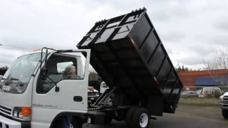 Town and Country Truck #5997: 2004 Isuzu NPR 12 Ft. Flatbed Landscape Dump Truck