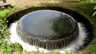 円筒分水@富山県南砺市_赤祖父溜池の円筒分水槽