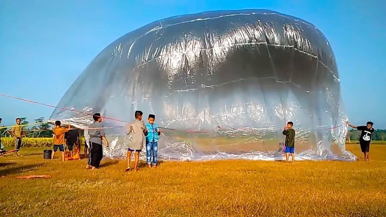 """إطلاق بالونات عملاقة ترتفع إلى 10,000 متر في السماء دخول """"موسوعة جينيس"""""""