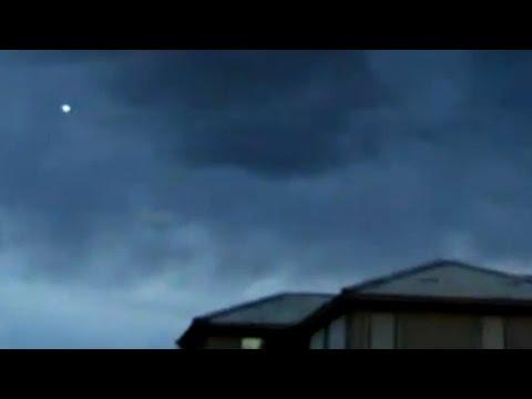 Blue Colored UFO with Glowing Light During Thunderstorm over Buckeye, Arizona - FindingUFO
