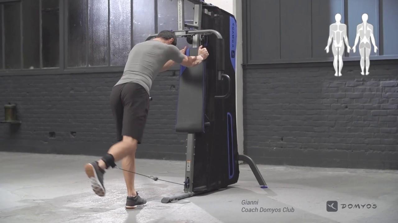 Exercice kick back a la poulie basse home gym compact