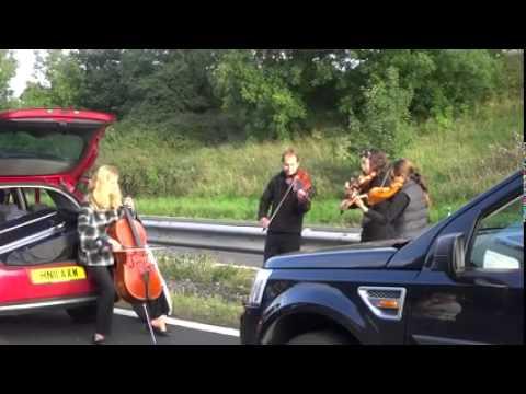 String quartet play during M5 traffic jam in Somerset
