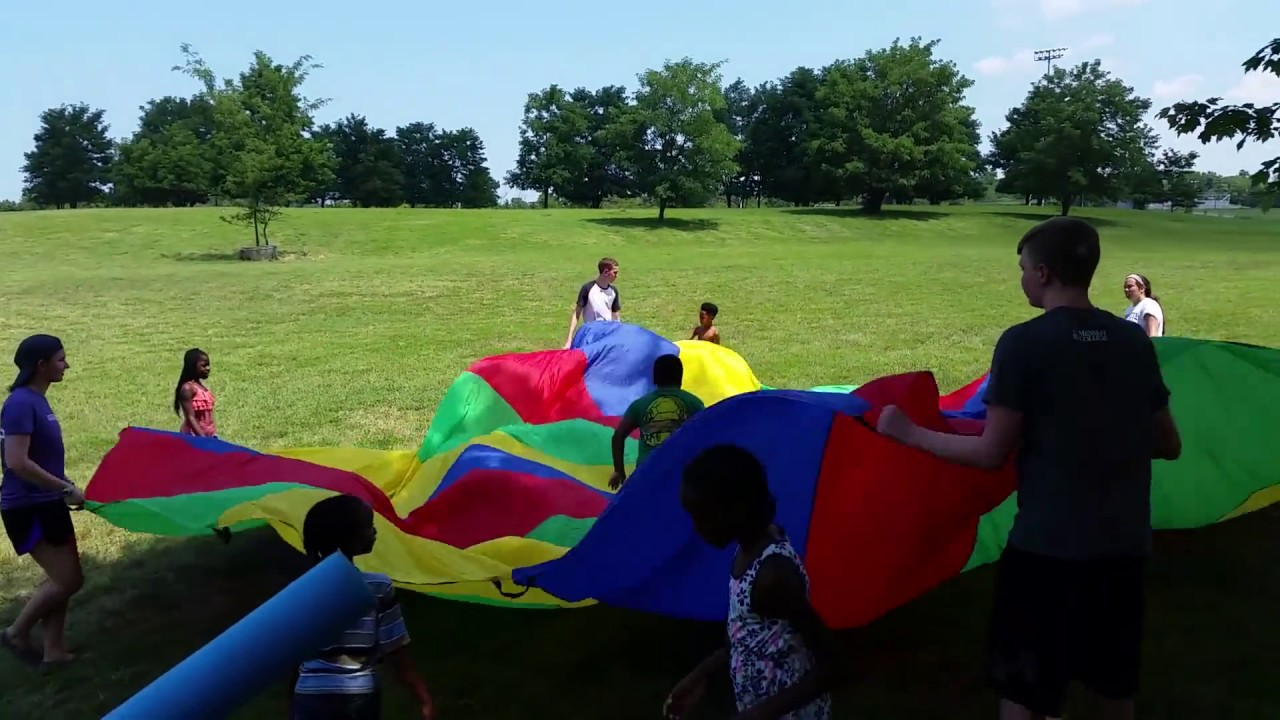 Kids Trying To Obey And Ella Leading Parachute Games