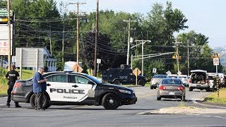 Two officers among four killed in Fredericton
