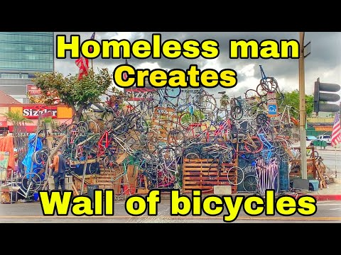 Homeless Creates Wall Of Bicycles next to encampment in Koreatown Los Angeles thumbnail