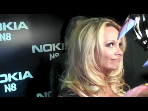 Pamela Anderson Is Interviewed At The Commuter Premiere