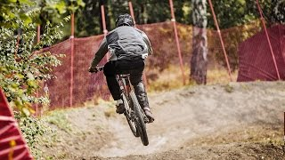 cyclist downhill riding Insloped Turn