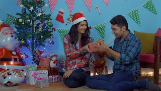 Happy Christian wife surprising her husband with special Christmas present in India