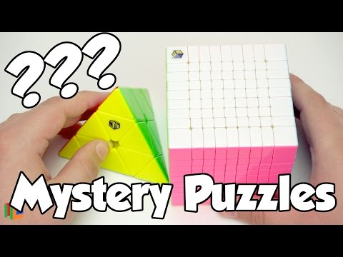 New Mystery Puzzles Unboxing (Yuxin HuangLong 9x9 And X-Man Bell Pyraminx) | TheCubicle.us