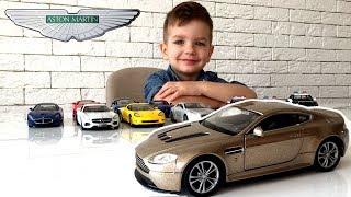 Машинка Welly Aston Martin V12 Vantage. Полиция находит целый склад угнанных машин.
