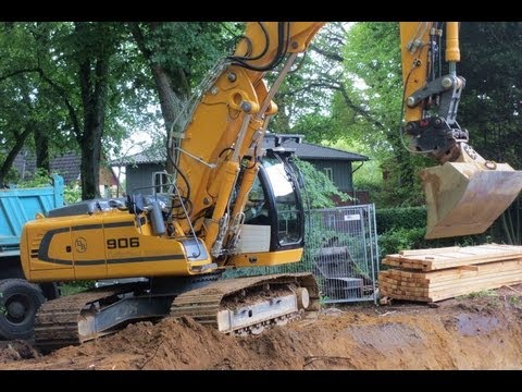 Liebherr excavator 906 digging with tilt bucket in borrow for Digging ground dream meaning