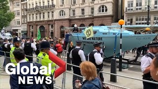 """Climate activists disrupt parts of London with """"summer uprising"""""""