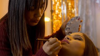 Indian makeup professional preparing bride for her wedding day - bridal makeup
