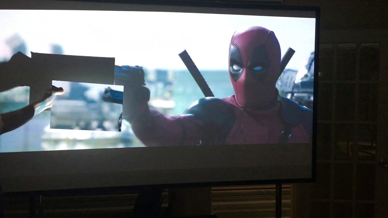 Optoma P1 CinemaX Projector against 2 different screen