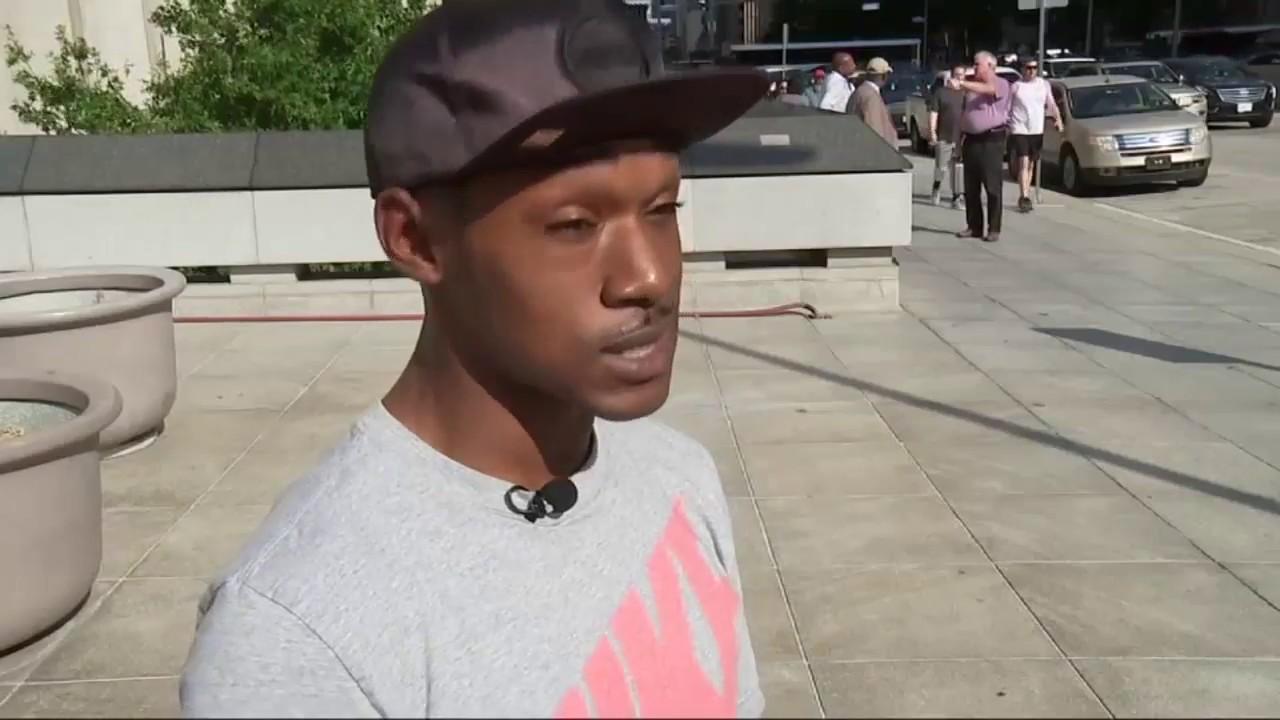 afc6ec4900153 Man Goes Viral Shading Woman with Umbrella at Bus Stop - YouTube