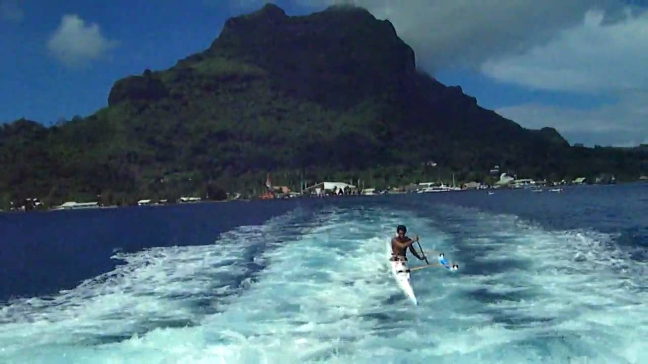 Outrigger Canoe In Tahiti Rides Boat Wake And Flips Kayak